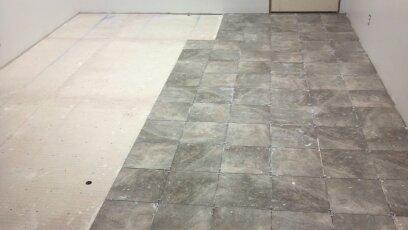 installing tile kitchen floor.
