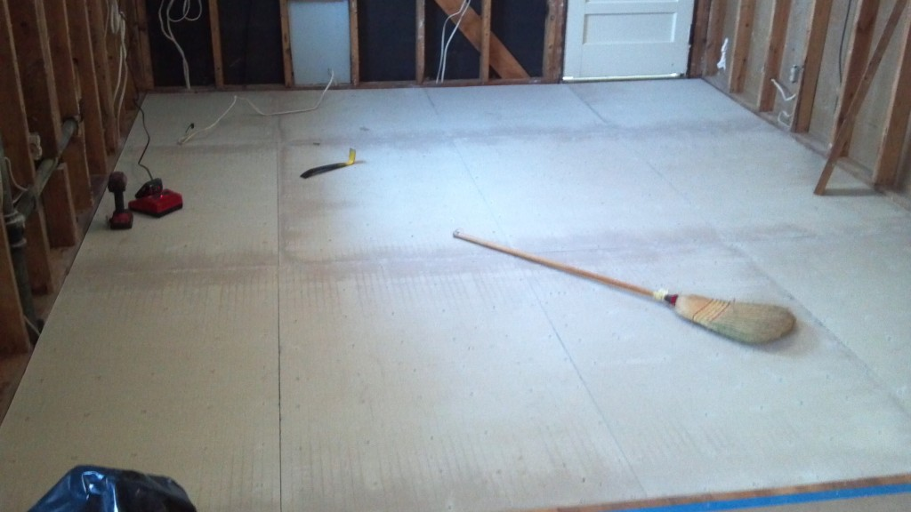 Cleaning new hardy backer sub floor for tile install.